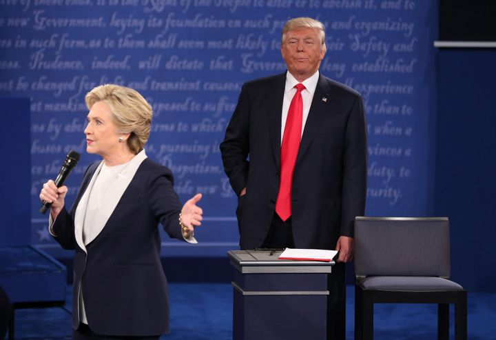 Hillary Clinton speaks as Donald Trump stands during the second U.S. presidential debate at Washington University in St. Loui