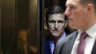 Retired Lieutenant General Michael Flynn, White House national security adviser-designate, stands in the elevator at the Trump Tower in New York, U.S., on Monday, Dec. 5, 2016. More than six weeks before his inauguration, President-elect Donald Trump is already carrying out his promise to make U.S. foreign policy less predictable with a series of moves that are keeping America's adversaries, as well as its friends, off-balance. Photographer: John Angelillo/Pool via Bloomberg