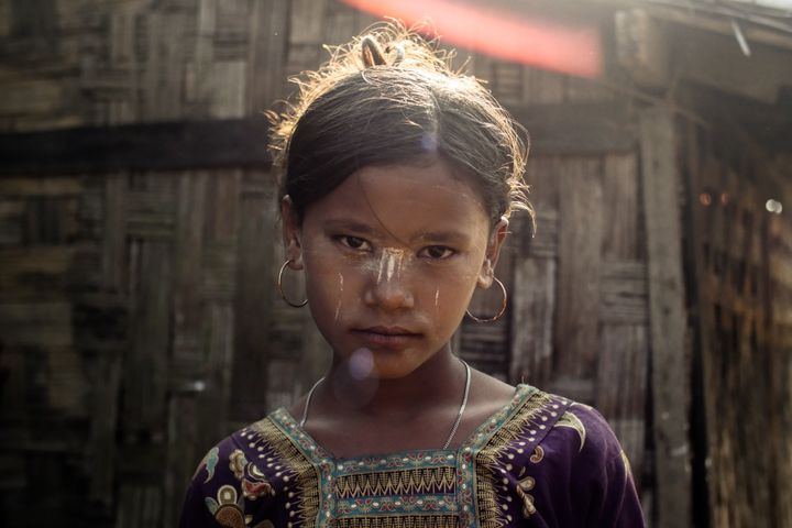 A Rohingya girl living in confinement outside of Site, Myanmar.