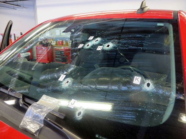 Bullet holes mark the windshield of the Chevrolet Silverado truck that Pedro Villanueva was driving when California Highway P