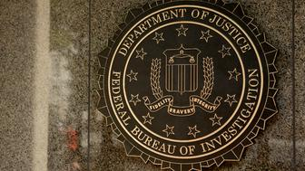 The seal of the Federal Bureau of Investigation (FBI) is seen at the J. Edgar Hoover building in Washington, D.C., U.S., on Thursday, Aug. 8, 2013. The FBI is a governmental agency as a division of the U.S. Department of Justice (DOJ) established in 1908. Photographer: Andrew Harrer/Bloomberg via Getty Images