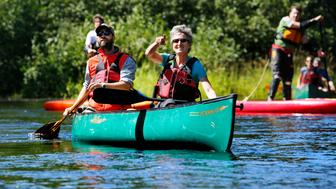 PATTEN, ME - AUGUST 27: U.S. Secretary of the Interior Sally Jewell points out a Great Blue Heron while paddling the East Branch of the Penobscot River with Lucas St. Clair, President of Elliotsville Plantation, Inc. during a tour of Katahdin Woods and Waters National Monument. (Photo by Derek Davis/Portland Press Herald via Getty Images)