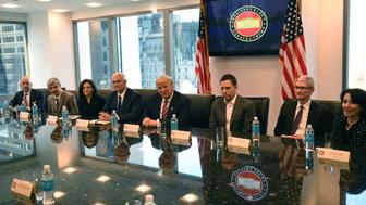 (L-R) Amazon's chief Jeff Bezos, Larry Page of Alphabet, Facebook COO Sheryl Sandberg, Vice President elect Mike Pence, President-elect Donald Trump, Peter Thiel, co-founder and former CEO of PayPal, Tim Cook of Apple and Safra Catz of Oracle attend a meeting at  Trump Tower December 14, 2016 in New York. / AFP / TIMOTHY A. CLARY        (Photo credit should read TIMOTHY A. CLARY/AFP/Getty Images)
