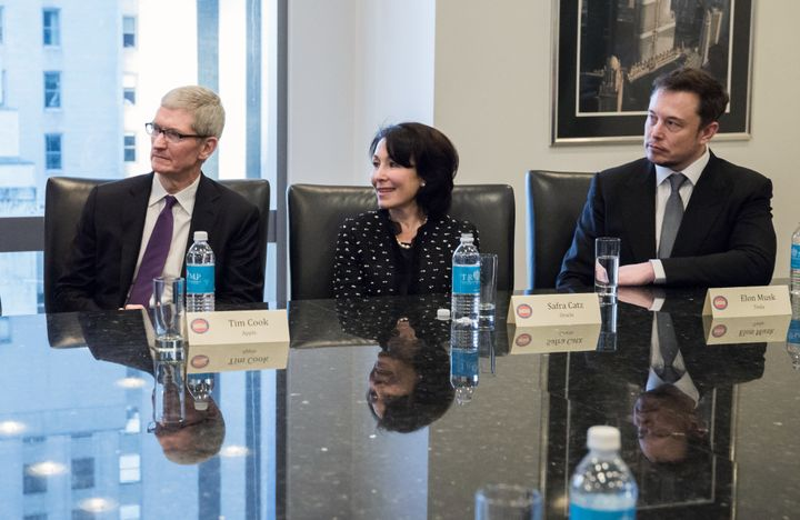 Tim Cook, chief executive officer of Apple Inc., from left, Safra Catz, co-chief executive officer of Oracle Corp., and Elon