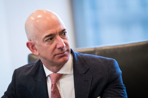 Jeff Bezos, chief executive officer of Amazon, listens during a meeting of technology executives and...