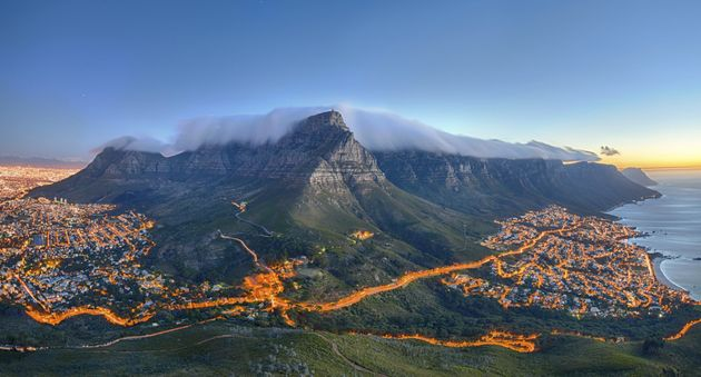 Table Mountain covered by its typical cloud table cloth and the twelve