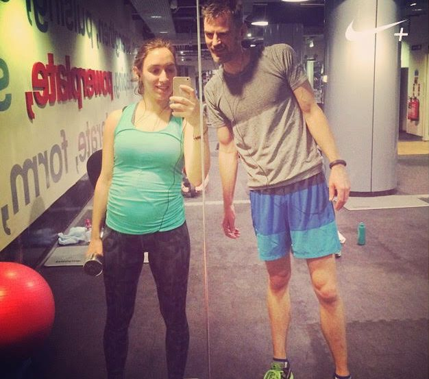 Alison Whitehouse working out with her husband while she was pregnant.