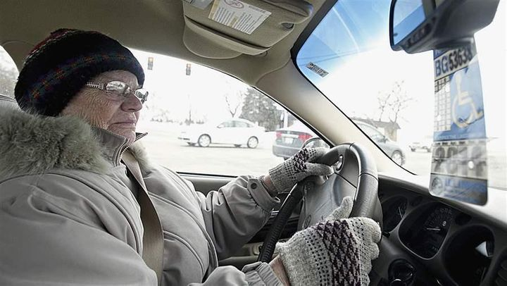 Dorothy Bierman makes a right turn while driving in DeKalb, Illinois. Licensing requirements for older drivers vary widely fr