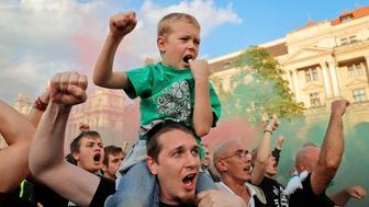 Supporters of Hungarys policies on migration gesture during a concert by nationalist group Romantic Violence on the eve of the referendum