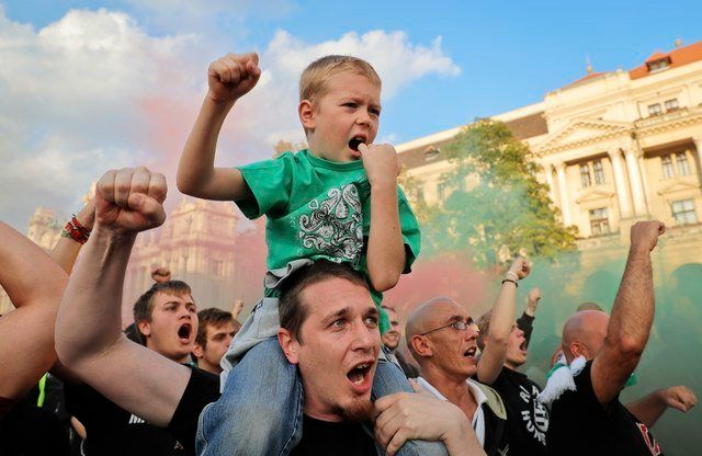 Supporters of Hungary's policies on migration gesture during a concert by nationalist group Romantic Violence, on the e