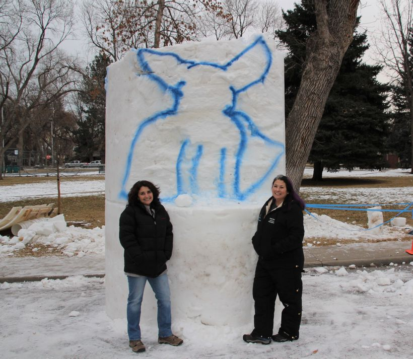 "Harley's ""mom"" Rudi Taylor (left) and Kerri Ertman (right) standing with, what will soon be, Snow Harley!"