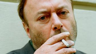 Writer Christopher Hitchens (1949 - 2011) portrait, smoking a cigarette, London, circa 2000. (Photo by Eamonn McCabe