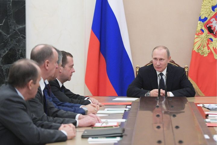 Russia's President Vladimir Putin and Russia's Prime Minister Dmitry Medvedev at a Russian Security Council meeting at the Mo