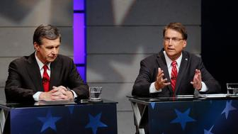Candidates for Governor of North Carolina, from left, Democrat Roy Cooper and Republican Gov. Pat McCrory, debate at WRAL studios in Raleigh, N.C., on Tuesday, Oct. 18, 2016. (Chris Seward/Charlotte Observer/TNS via Getty Images)