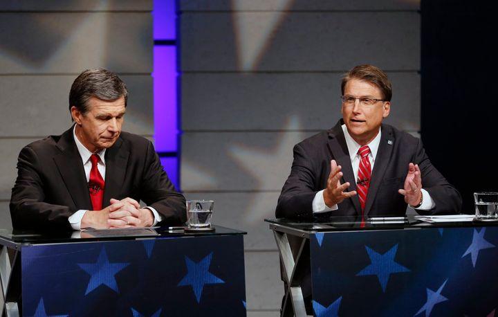 Roy Cooper, who is now North Carolina's Democratic governor-elect, appearsat a debate with his Republican predecessor,&