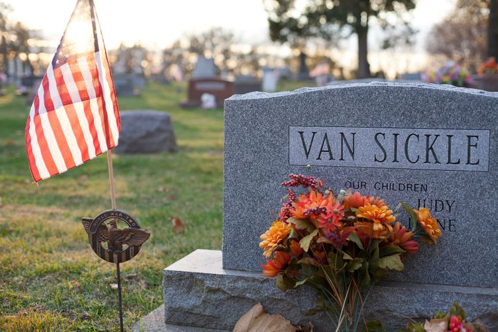 The sun sets behind the grave of my grandfather, Wayne VanSickle, Delphi's long-time mayor.