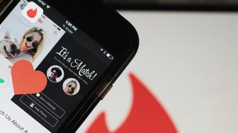 The Tinder Inc. application is displayed on a smartphone in an arranged photograph in New Delhi, India, on Friday, July 29, 2016. Dozens of dating apps have emerged in India over the past couple of years, in a nation where most weddings are still arranged and sex before marriage remains largely taboo. Dating startups say the effort is justified because half of India's 1.3 billion people are under 25, increasingly global and presumably open to shedding some reserve. Photographer: Sara Hylton/Bloomberg via Getty Images