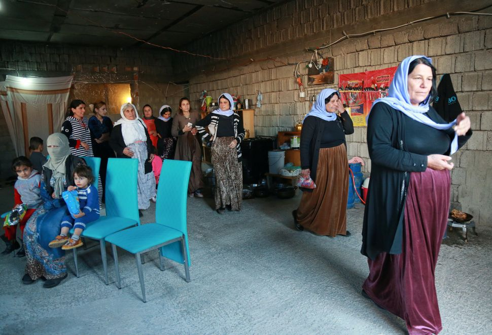 Displaced Yazidi women at a house in Duhok in northern Iraqi Kurdistan in November.