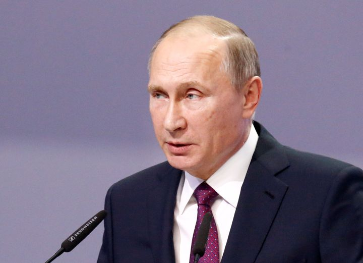 Russian President Vladimir Putin delivers a speech during an international conference dedicated to the 175th anniversary of S