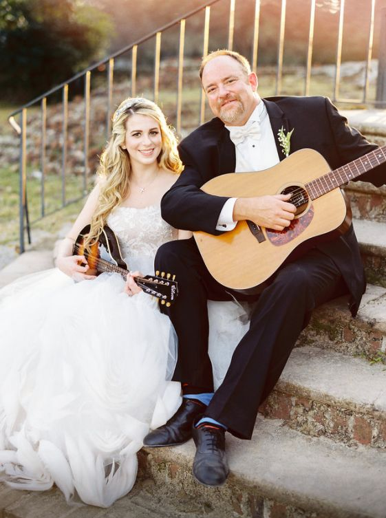 The couple took some time to sit and play their instruments on the big day.