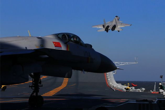 A live-fire drill using an aircraft carrier is seen carried out in the Bohai sea, China, December 14,