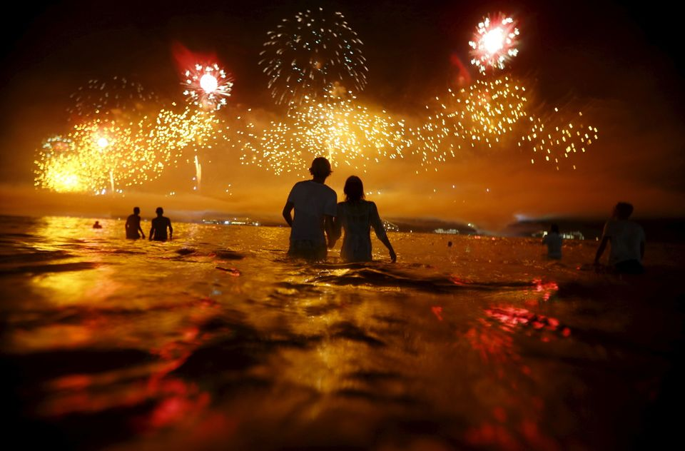 People watch as fireworks explode over Copacabana beach during New Year's celebrations in Rio de Janeiro, Brazil, on Jan. 1.