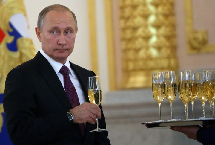 Putin takes a glass of champagne during the reception for new foreign ambassadors at the Grand Kremlin Palace. Nov. 9. Moscow