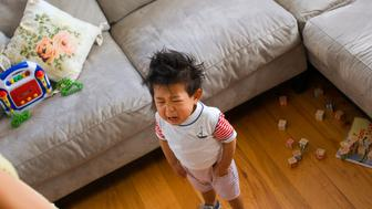 Child crying in living room