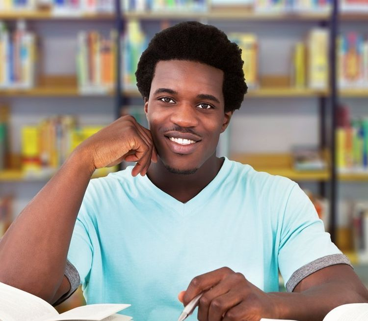 Young African Man Studying In College