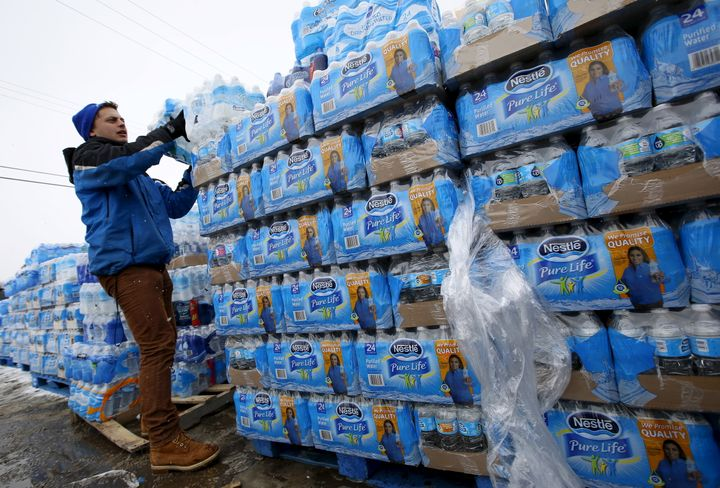Volunteers distribute water in Flint, Michigan. America's lead-contaminated water problem is likely bigger than we currently