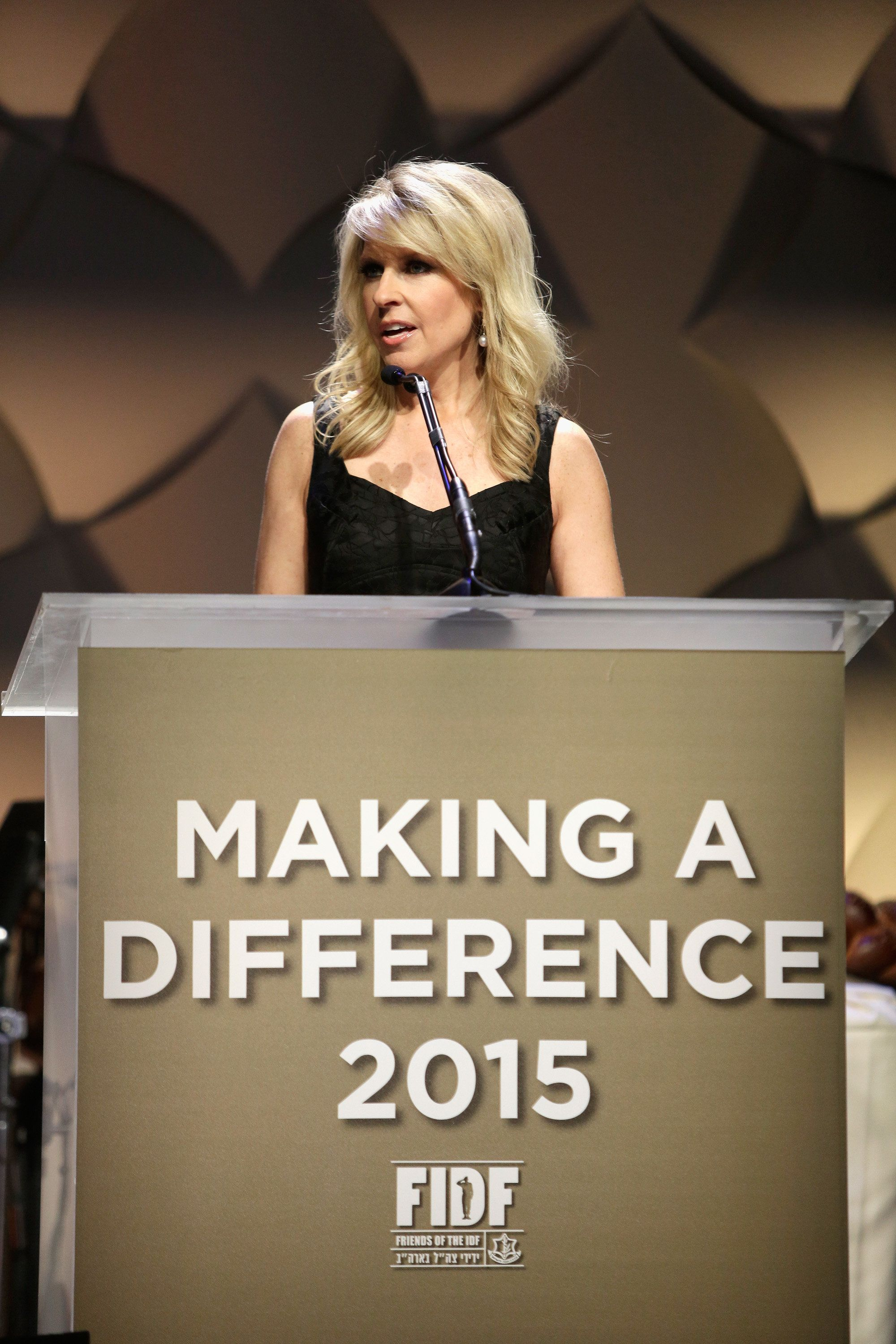 BEVERLY HILLS, CA - NOVEMBER 05:  Mistress of Ceremonies Monica Crowley speaks onstage during Friends Of The Israel Defense Forces Western Region Gala at The Beverly Hilton Hotel on November 5, 2015 in Beverly Hills, California.  (Photo by Tiffany Rose/WireImage)