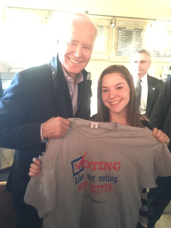 """<p>Michelle gives VP Biden his very own """"Election Central"""" T-shirt with the winning student slogan, """"Voting. Like not voting, but better.""""</p>"""