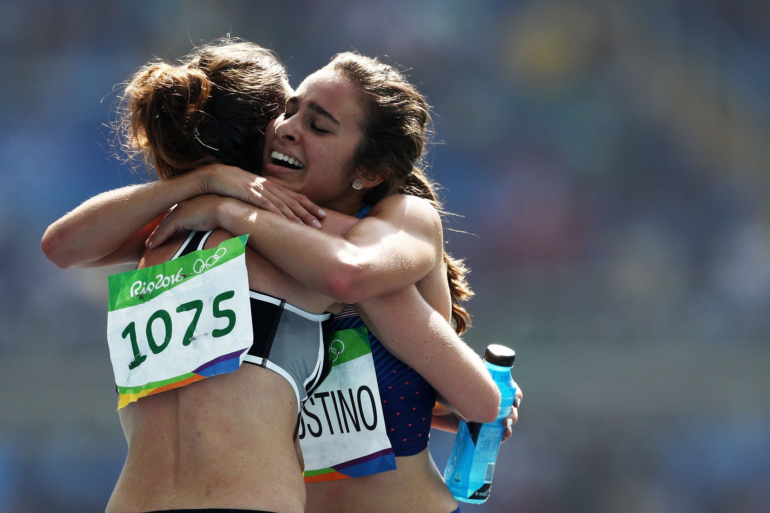 Abbey D'Agostino of the United States, right, hugs Nikki Hamblin of New Zealand, left, after the second heat of the women's 5