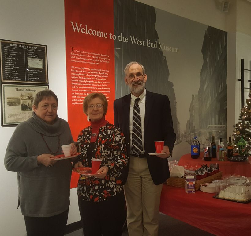 Museum Director Susan Hanson,  attendee Una McMahon, and board member Bill Kuttner at the West End Museum holiday party.