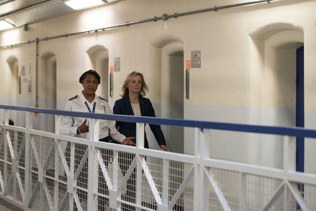 Justice Secretary Liz Truss, seen here right on an earlier prison visit, spoke on