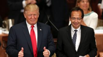 Republican presidential candidate Donald Trump gives the thumbs up while standing with John Paulson at a luncheon for the Economic Club of New York in New York, Thursday, Sept. 15, 2016. (AP Photo/Seth Wenig)