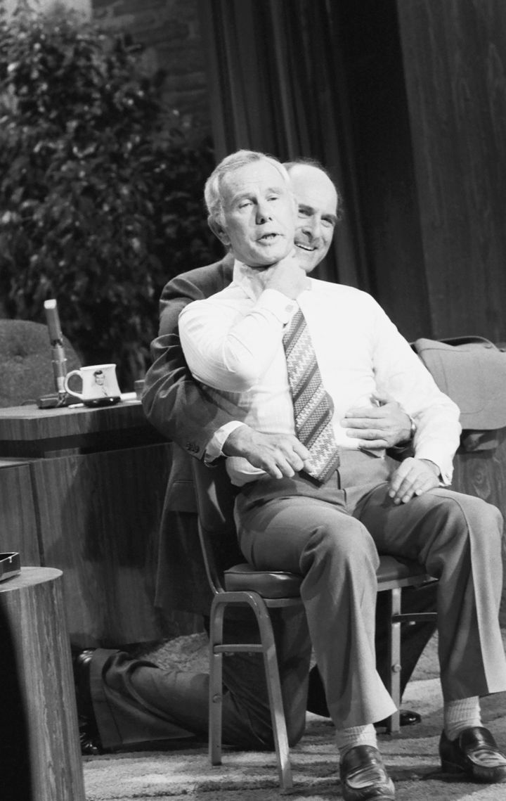 Dr. Henry heimlich demonstrates the heimlich maneuver on host Johnny Carson on April 4, 1979