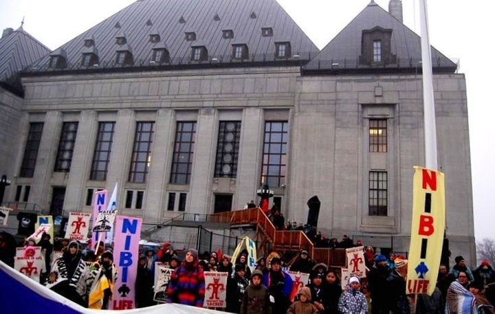 Protesters rally in front of the Supreme Court of Canada in Ottawa for the hearing in the Clyde River case.