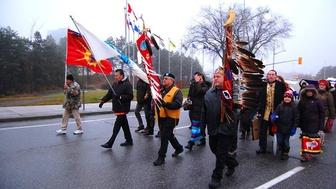 Protesters march toward the Supreme Court of Canada in Ottawa on November 30 2016