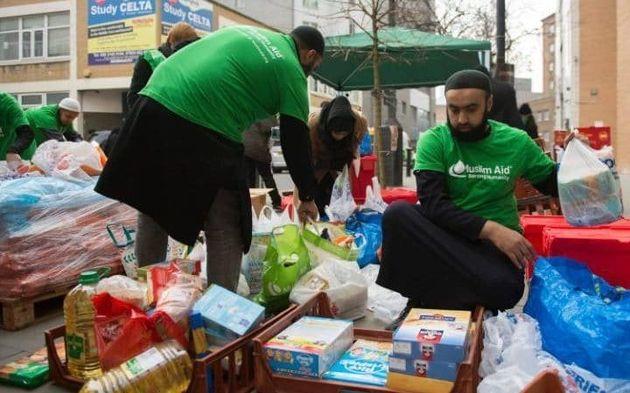 Volunteers from Muslim Aid sort through the