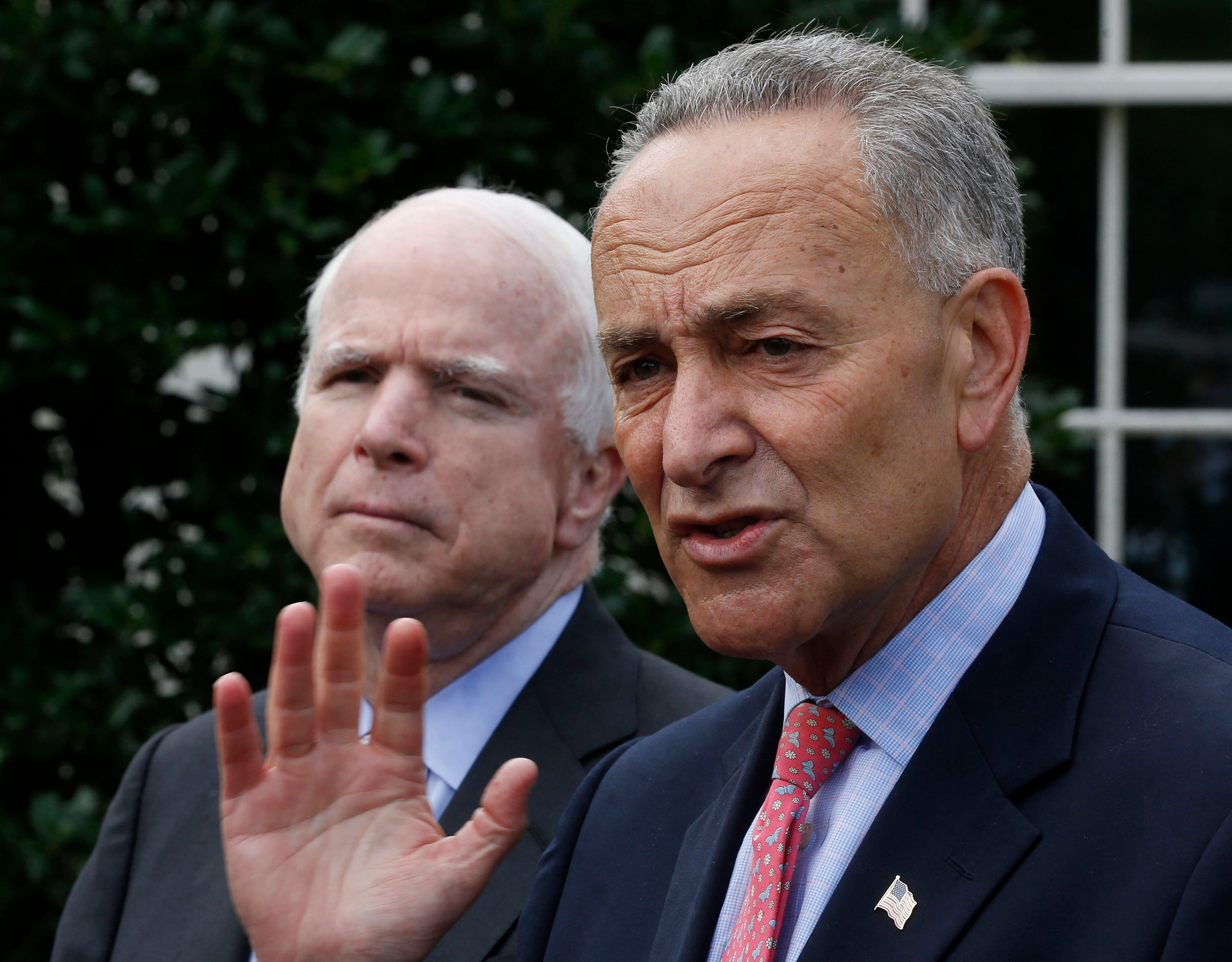 U.S. Senators Charles Schumer (D-NY), R, and John McCain (R-AZ) speak to the media after meeting with U.S. President Barack Obama about immigration reform in Washington July 11, 2013. REUTERS/Larry Downing  (UNITED STATES - Tags: POLITICS SOCIETY IMMIGRATION)