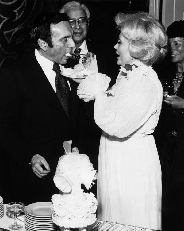 "Gabor feeds cake to her sixth husband, Jack Ryan, in 1975. According to <a href=""https://www.theguardian.com/film/2016/dec/19"