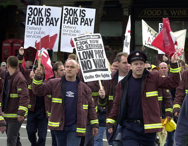 Firefighters march to Trafalgar Square, London, for a rally to demand a pay increase in