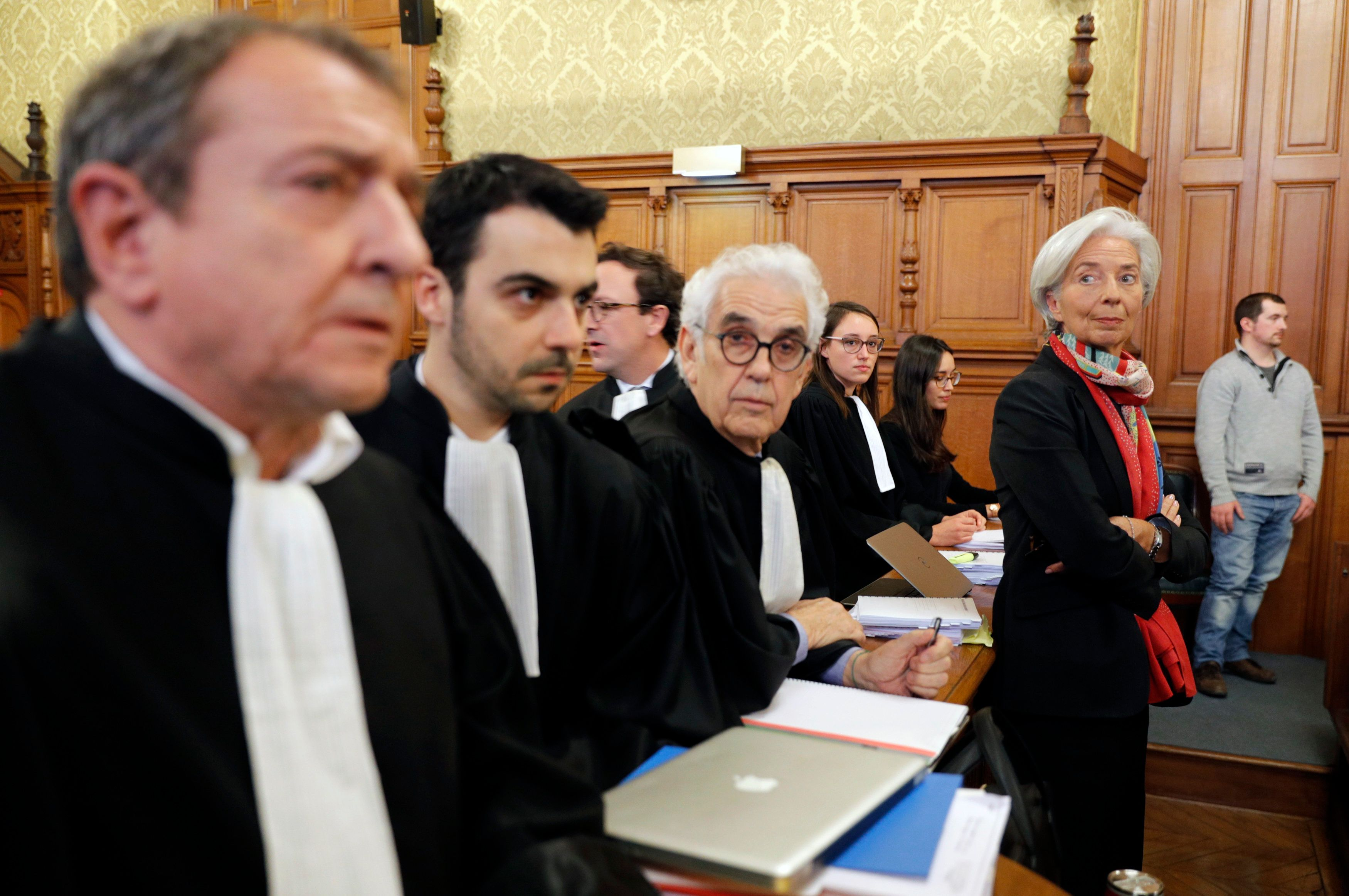 Managing Director of the International Monetary Fund (IMF) Christine Lagarde (R) stands with her lawyers before the start of her trial about a state payout in 2008 to a French businessman, at the courts in Paris, France, December 12, 2016.   REUTERS/Philippe Wojazer