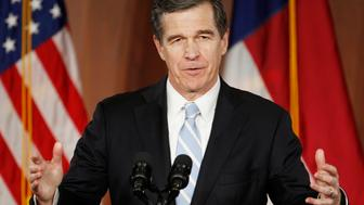 North Carolina Governor-elect Roy Cooper speaks to supporters at a victory rally the day after his Republican opponent and incumbent Pat McCrory conceded in Raleigh, North Carolina, U.S., December 6, 2016.     REUTERS/Jonathan Drake