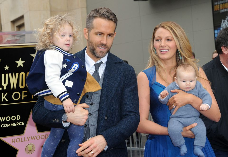 HOLLYWOOD, CA - DECEMBER 15: Actor Ryan Reynolds and  Actress/wife Blake Lively and with daughters  James and unrevealed at