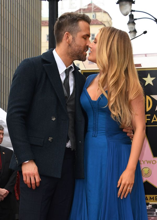 Actor Ryan Reynolds kisses his wife Blake Lively during the Deadpool actors Hollywood Walk of Fame ceremony in Hollywood, Cal