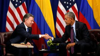 U.S. President Barack Obama shakes hands with Colombian President Juan Manual Santos during their meeting in New York September 21, 2016. REUTERS/Kevin Lamarque