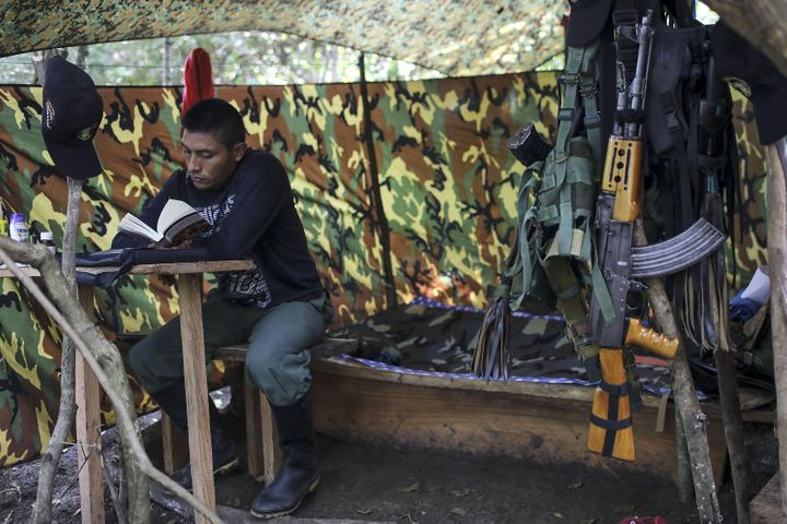A FARC guerrilla reads a bookat a camp near Conejoin northern Colombia on Dec. 6.
