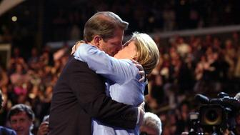 LOS ANGELES, UNITED STATES:  Democratic presidential candidate Al Gore kisses his wife Tipper after she introduced him to the Democratic National Convention at the Staples Center 17 August 2000 in Los Angeles, California.   AFP PHOTO/Lucy NICHOLSON (Photo credit should read LUCY NICHOLSON/AFP/Getty Images)